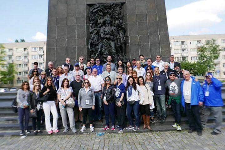Adult marchers at Warsaw ghetto memorial