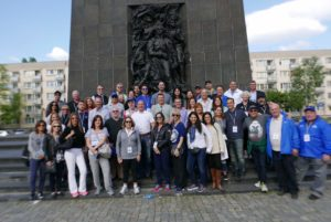 Image of Adult March of the Living Group in Front of Warsaw Ghetto Uprising Monument