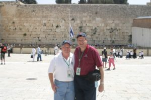 Image of Mel Mann and Irv Kempner in front of the Kotel western wall