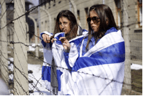 Image of Teens wrapped in Israeli flags