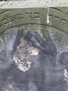 Image of Headstone iconography of a Cohen mitzavah headstone Cohen priestly blessing hands arrangement