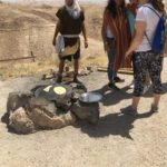 Image of Starting at the Kotel to camel rides and making pita bread outside.