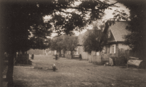 Image of The store and home of Yankev and Perl Rebejkow on a street in Jeziory, ca. 1900.