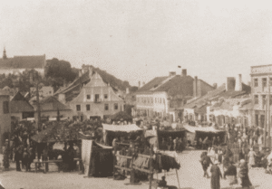 Image of Sale of clothing at the market in Krazimierz nad Wisła (Yiddish: Kuzmir), ca. 1920.