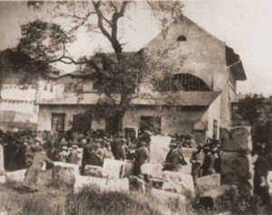 Image of Jews praying at the tombstone of REMA (Rabbi Moses Isserles) o Lag ba'Omer, the anniversary of his death.
