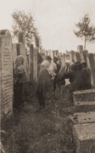Image of Professional Mourners (klogerins) in the cemetery in Brody.