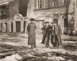 Image of Hasidim outside a house of prayer on Saturday. Cracow, 1938.