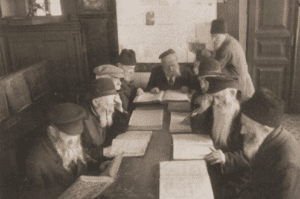 Image of Men studying the Talmud in the bethmedresh of a home for the aged at 17 Portowa Street, Vilna, 1937.