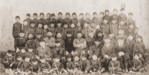 Image of Rabbi Binyomin Graubart, with teachers and students of the Mizrachi Talmud Torah on Lag ba'Omer, Staszow.