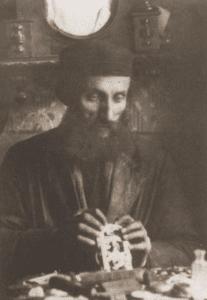 Image of Naftole Grinband, a clockmaker. Gora Kalwaria (Yiddish: Ger), 1928.