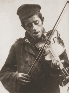 Image of Zisl, the street musician. Staszow, 1930s.