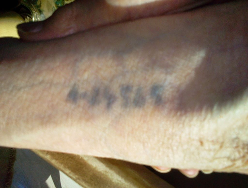 Image of The tattooed forearm of Malka Freidenreich Kempner.