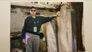 Image of Irv pictured with Great Grandfather's headstone Warsaw Cemetery