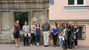 Image of Irv in front of his dad's apartment building with Kalisz Students of Dialog
