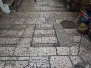 Image of Jerusalem market cobblestone street.