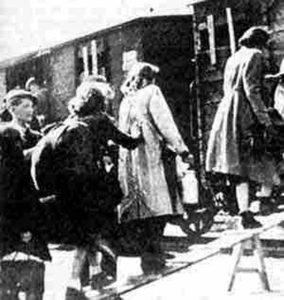 Image of Children boarding box cars to Auschwitz