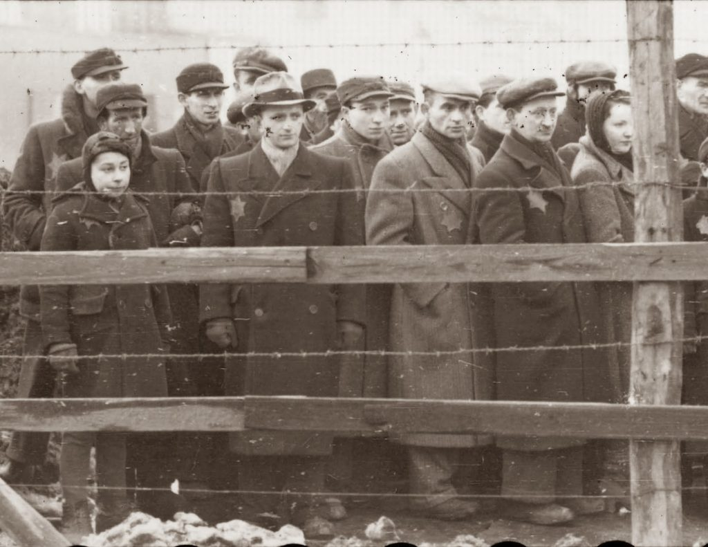 People with Jewish star behind barbwire