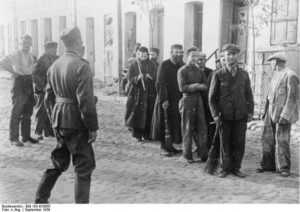 Image of Warsaw Ghetto workers round up WWII picture.