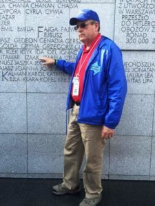 Image of Irv pointing to his Hebrew name Issac inscribed at Umschplatz Warsaw Ghetto Memorial.