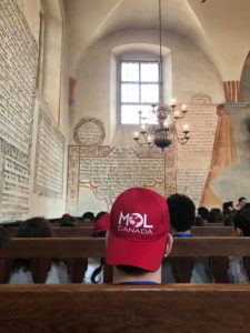 Image of MOTL students visit Tycochin in April 2018, town and burial pits where Jews were shot.