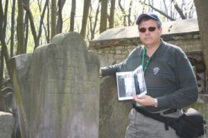 Image of Irv next to his Great Grandfather's graves.